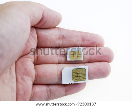 Sim and micro-sim card In a hand isolated on white background. - stock photo
