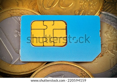 sim card and euro coins money, close up - stock photo