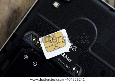 sim card and micro sd card on smart phone, soft focused - stock photo