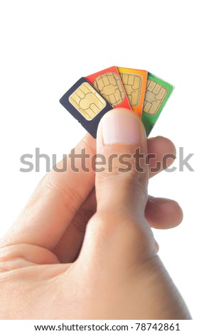 Sim card In a hand isolated on white background - stock photo