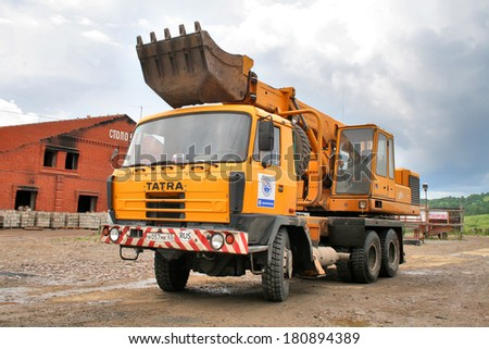 SIM, RUSSIA - AUGUST 6, 2008: Yellow Tatra T815 UDS 214 excavator truck at the interurban road. - stock photo