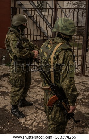 SIMFEROPOL, CRIMEA, UKRAINE - MARCH 5 2014: Russian troops turn their backs from the camera.
