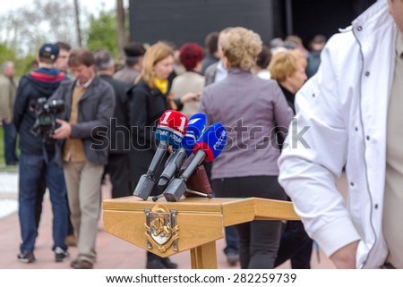 Simferopol, Red, Crimea - May 8, 2015: the opening of the memorial to the victims of fascism on the site of the concentration camp of death. Microphones waiting for the press conference