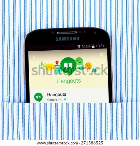 Simferopol, Russia - April 18, 2015: Photo of Hangouts application on the Samsung galaxy display. Google Hangouts is an instant messaging and video chat platform developed by Google. - stock photo