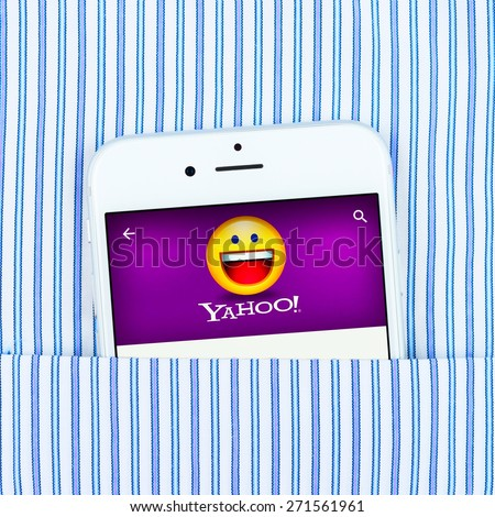 Simferopol, Russia - April 18, 2015: White Apple iPhone 6 in the pocket displaying Yahoo application. Yahoo Inc. is an American multinational Internet corporation headquartered in California. - stock photo