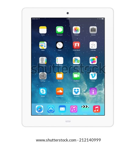 SIMFEROPOL, RUSSIA - AUGUST 21, 2014: Apple iPad displaying iOS 7.1.2 homescreen. iOS 7.1.2 operating system designed by Apple Inc. Official release of 30 June 2014. - stock photo