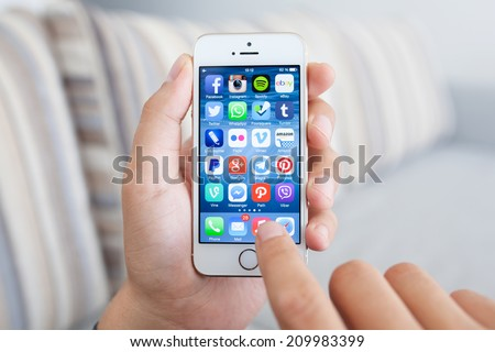 Simferopol, Russia - July 14, 2014: Displaying social media network program known brands on the screen iPhone from Apple. - stock photo