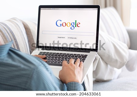 Simferopol, Russia - July 13, 2014: Google biggest Internet search engine. Google.com domain was registered September 15, 1997. - stock photo