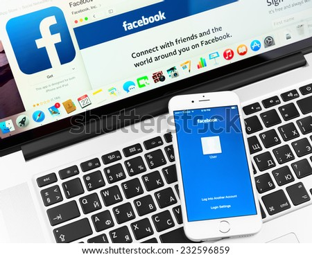 SIMFEROPOL, RUSSIA - NOVEMBER 22, 2014:  Facebook application on Apple iPhone 6 and Macbook display. Facebook is largest and most popular social networking site in the world. - stock photo
