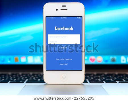 SIMFEROPOL, RUSSIA - NOVEMBER 01, 2014: Facebook Login page on black Apple iPhone screen. Facebook is largest and most popular social networking site in the world. - stock photo