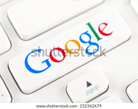 SIMFEROPOL, RUSSIA - NOVEMBER 22, 2014: Google logotype printed on sticker and placed on a button. Google is American multinational corporation specializing in Internet-related services and products