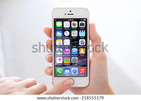 Simferopol, Russia - September 19, 2014: Apple iPhone 5S displaying iOS 8 homescreen. iOS 8 mobile operating system designed by Apple Inc. is an upcoming September 17, 2014. - stock photo