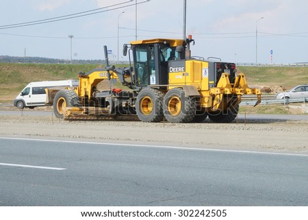 Simferopolskoye Highway, Moscow region, Russia, April, 27, 2015: the technician, taking part in works on reconstruction of Simferopolskoye Highway in the Moscow region, Russia