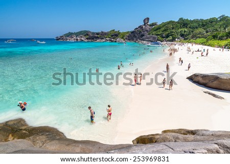 SIMILANS, THAILAND - MARCH 7: Peoples tourists at Beach of Koh Similan No.8 Island with Sailing Boat Rock in Similan national park, Thailand. On March 7, 2014.  - stock photo