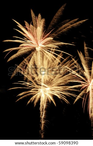 Similar bursts of fireworks with feathery motion blur - stock photo