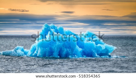 Similar to blue rose iceberg floating on Arctic ocean (fresh ice). - Wow, that's a lot of ice for whiskey!