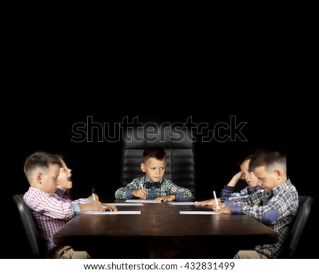 similar young businessmen sitting at a table - stock photo
