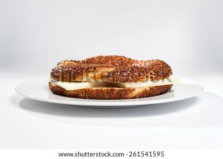 Simit (Turkish bagel) on white - stock photo