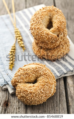 Simit - turkish style bagels in order with wheat - stock photo