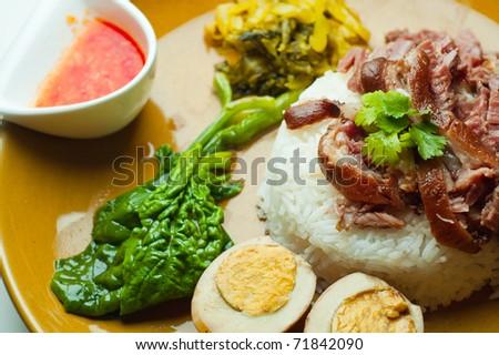Simmerd pork shank on rice - stock photo