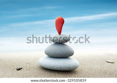 Simple abstract background of red and grey stones arranged in pyramid stack  - stock photo