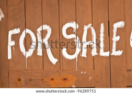 Simple advertising by paint on wooden wall