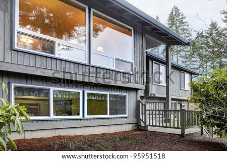 Simple American split level house exterior. - stock photo