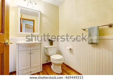 Simple bathroom interior with white vanity cabinet and hardwood floor. Northwest, USA