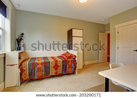 Simple bedroom interior with one single bed and cabinet
