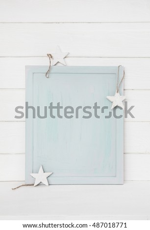 Simple blue turquoise christmas background with white stars on wooden background for a mock up presentation.