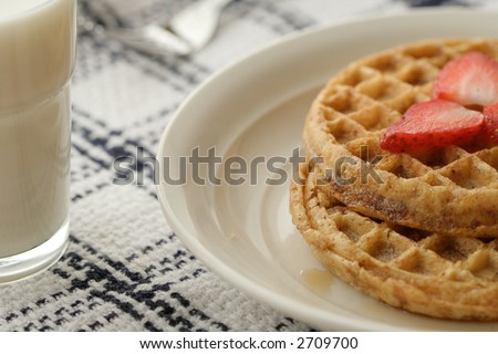 Simple breakfast made of waffles and milk