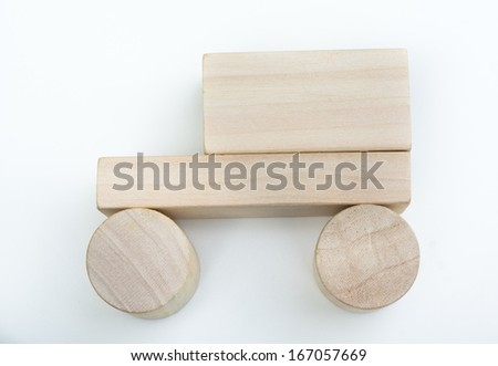 simple car symbol made with wood blocks over white