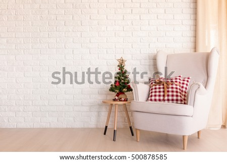 Simple Christmas living room with armchair and small Christmas tree