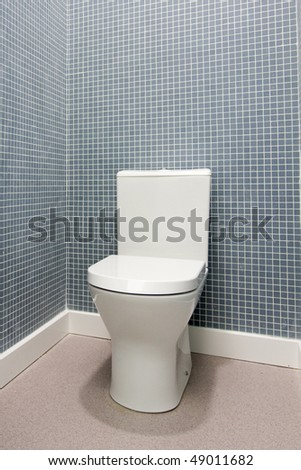 Simple, clean and white toilet in a bathroom - stock photo