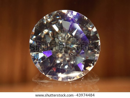 Simple elegant diamond with reflection on the floor.