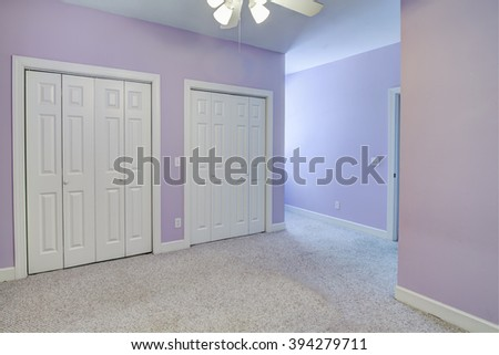 Simple empty, bedroom with double closets