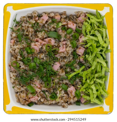 Simple high calorie tasty fat  rural food. Buckwheat cereal porridge with ham sausage  and a green salad. Isolated. Top view shot - stock photo