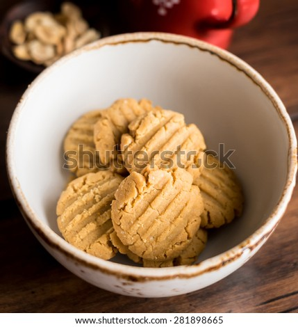 Simple homemade peanut butter cookies with chocolate chips and oatmeal in a bowl, selective focus - stock photo