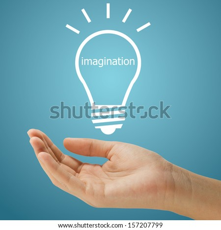 simple lightbulb with imagination word floating on women hand on blue background - stock photo