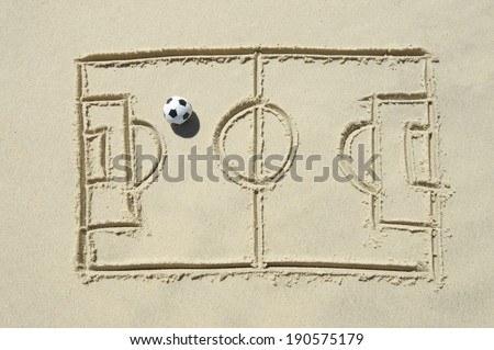 Simple line drawing of football pitch with soccer ball in sand on Brazilian beach Rio de Janeiro - stock photo