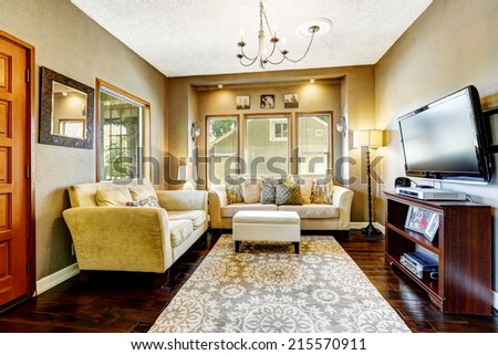 Simple living room interior. Comfortable couches and tv - stock photo
