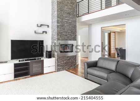 simple living room with white color scheme and high end features - stock photo