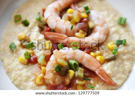 simple meal of shrimp and grits with sauteed vegetables - stock photo