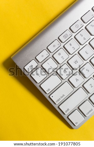 Simple metal, white keyboard with yellow background