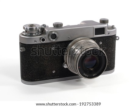 Simple old analog camera on white - stock photo