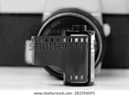 Simple old analog camera with film, black and white - stock photo