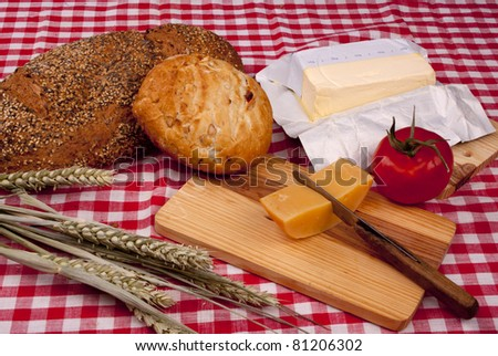 Simple old fashioned breakfast with bread and cheese - stock photo