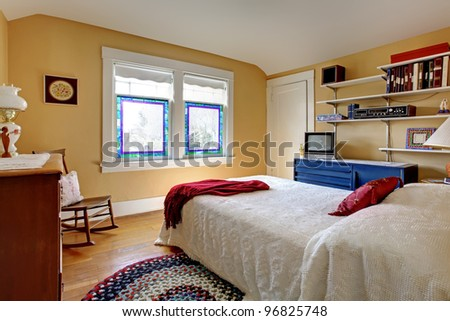 Simple old house bedroom interior with white bed.