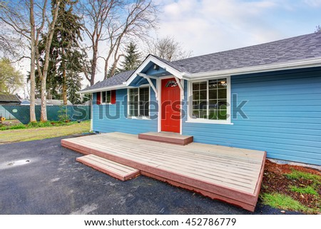 Blue house backyard concrete floor patio stock photo for Simple american house