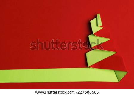 Simple paper christmas tree background with copy space